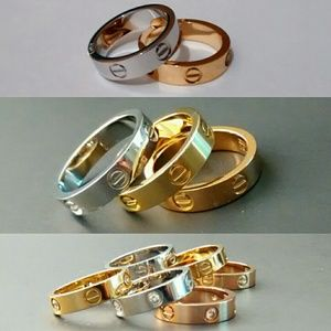 Various 18k over stainless screwdriver love rings